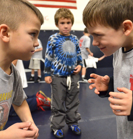 Danvers:  6-year-old Carson Milovanovic, left, of North Andover, and Colin Nugent of Boxford, 6, stare each other down at wrestling practice.    photo by Mark Teiwes / Salem News