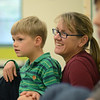 "Hamilton: Nico Moldovean, 8, of Wenham and his mom Melanie listen to a reading of the book ""Pete's a Pizza"" during Rhythm and Rhyme story time at the Hamilton-Wenham Public Library.  photo by Mark Teiwes /  Salem News"