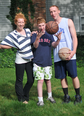 Danvers: Sean Mahegan, right, is a Danvers High recent graduate who will be representing the school in the Agganis Boys Basketball All-Star Classic on Monday.  He stands with his sister Moira Rose and brother Lucas. photo by Mark Teiwes / Salem News