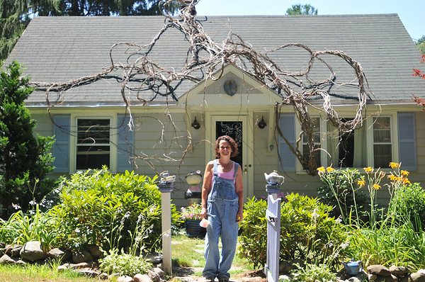 "Hamilton:  Artist Sue Kassirer created an installation titled ""Eminent Domain,"" of vines that twist and crawl around her home. Her work will be featured in the Art Grows Here exhibit.  photo by Mark Teiwes"