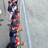 Lynn: Peabody West little league team watches a teammate up to bat.   photo by Mark Teiwes  / Salem News