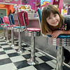 Danvers: Wylinn Palmisano, 6, spins on a chair at Goodies Ice Cream.  photo by Mark Teiwes / Salem News