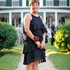Danvers: Kathy Bishop, the 2010 winner of the Danvers Family Festival Baron Mayer Award, stands in front of the Glen Magna mansion.  photo by Mark Teiwes / Salem News