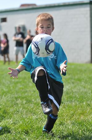 Theo Baldwin-Bowen, 5, works on his juggleing skills.