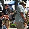 Salem:  Eric Reardon of Salem, center, rips up some improve jazz and blues with his band Global Stew. Noe Socha of Italy, left plays guitar and harmonica, and Festival co-founder Henley Douglas Jr. of Salem jumps in on tenor sax at the beginning of the Salem Jazz and Soul Festival.    photo by Mark Teiwes / Salem News