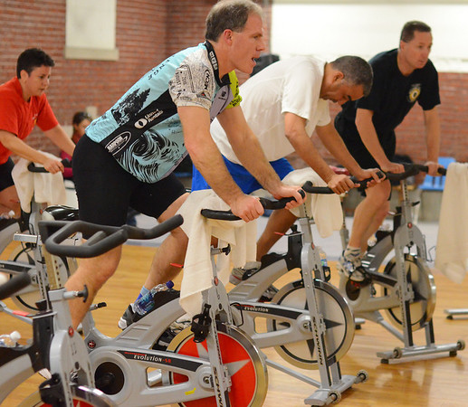 Salem:  Executive director at YMCA of the North Shore Debbie Amaral, left, Representative John Keenan, Sheriff Frank Cousins, and Salem Police Chief Paul Tucker participate in a Spin-a-thon fundraiser for the Salem Y, which raises money for people in Salem who would otherwise be unable to afford membership, programs, camp and child-care.  photo by Mark Teiwes  / Salem News