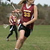 Topsfield: Newburyport's Haley Johnson carries the ball upfield on attack.    photo by Mark Teiwes / Salem News