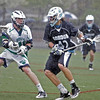 Beverly: As rain poured down, Gordon College's Jeremy Nelson, right, carries the ball followed by Endicott's Kevin Downes.  photo by Mark Teiwes / Salem News