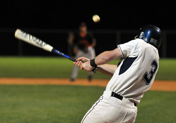 Danvers: Danvers player #3 Greg Little connects for a hit into right field.  photo by Mark Teiwes / Salem News