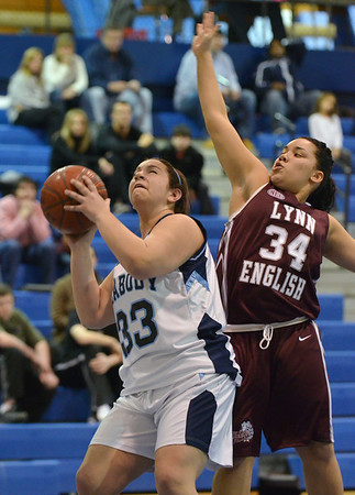 Peabody: Peabody's Carli Giacchino gets to the hoop for a shot past Lynn English defender Miranda Hogan.  photo by Mark Teiwes / Salem News
