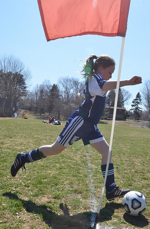 Middleton:  U-10 Hamilton-Wenham player makes a corner-kick.   photo by Mark Teiwes / Salem News