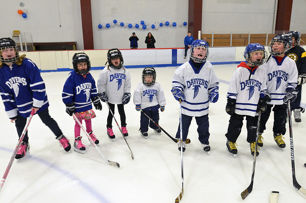 "Gloucester: Youth hockey players from the Danvers league yell, ""Go Danvers!"".  photo by Mark Teiwes  / Salem News"