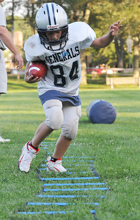 Hamilton:  Colby Cala, 9, works on his footwork with a ladder drill at a Hamilton-Wenham Youth Football practice.   photo by Mark Teiwes / Salem News