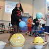 Salem: Saltonstall School students Brianna Valido, left, and Isaac Vrual get hands on practice putting the planets in order during a special science, technology and engineering MCAS review session. photo by Mark Teiwes / Salem News