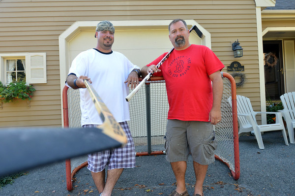 Beverly:  Former Beverly High hockey stars John Paluzzi, left, and Tim Mezza.   photo by Mark Teiwes /  Salem News