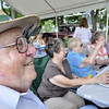 Peabody: Bob Hall enjoys a summer picnic with the St John the Baptist Church at Emerson Park. photo by Mark Teiwes / Salem News