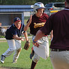 Tewksbury: Danvers National player Jackson McPherson beats out the throw from Peabody West's Connor Corrigan off a bunt.  photo by Mark Teiwes / Salem News