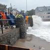 Salem: A crowd gathers at Juniper Beach to watch Tropical Storm Irene at high tide.   photo by Mark Teiwes / Salem News