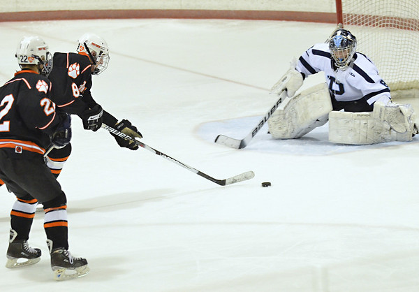 Salem:  Beverly boys hockey player Troy Cabral, center, is backed up by Connor Irving on a breakaway facing Peabody goalie Chis Ciampa.  photo by Mark Teiwes / Salem News