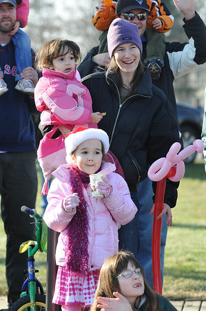 Danvers: Laura Koumarianos watches Santa arrive with her daugters Zoe, 2, left, and Kyla, 6.  photo by Mark Teiwes / Salem News