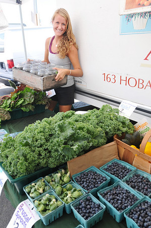Marblehead: Brenna Crowley of the Clark Farm in Danvers said that the Saturday farmers market was really busy, and they have had a good season overall.  photo by Mark Teiwes / Salem News
