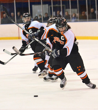 Salem:  Beverly girls hockey player Clare Leathersich winds up for a slapshot.  She assisted on Nicole Woods's game winning goal.  photo by Mark Teiwes / Salem News