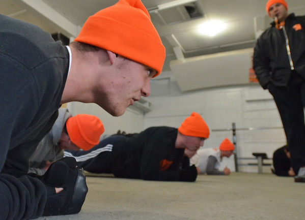 Beverly:   Beverly High School football player Matt Knight does an ab work out with his team in the clubhouse at Hurd Stadium.  photo by Mark Teiwes / Salem News