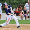 Woburn: Peabody West player Kyle Lynch reaches to hit for a double in the second inning.  He went on to score off a double by Ben Irvine.  photo by Mark Teiwes / Salem News