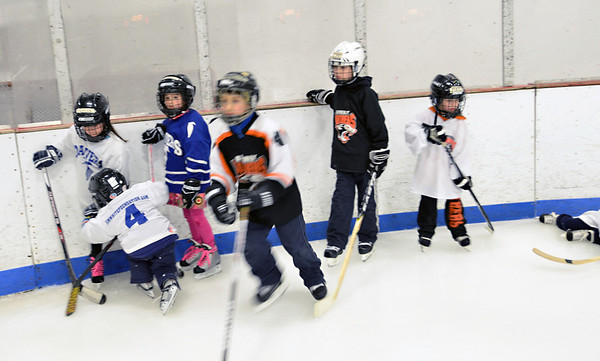 Gloucester: Youth hockey players from the Danvers and Beverly leagues line up for skating drills.  photo by Mark Teiwes  / Salem News