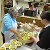 Peabody: Sylvie Cote, left, and Lauren Jackson volunteer preparing a meal at Haven from Hunger.  photo by Mark Teiwes  / Salem News