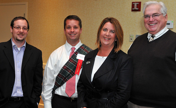 """Peabody:  Peabody Area Chamber of Commerce hosted a """"Knight of Toasting."""" Pictured from left, Tim Lasonde, of NSK Inc. Chris and Lynn Feazel, of AFLAC and members of the Chamber, and attorney Jim Burke.  photo by Mark Teiwes / Salem News"""
