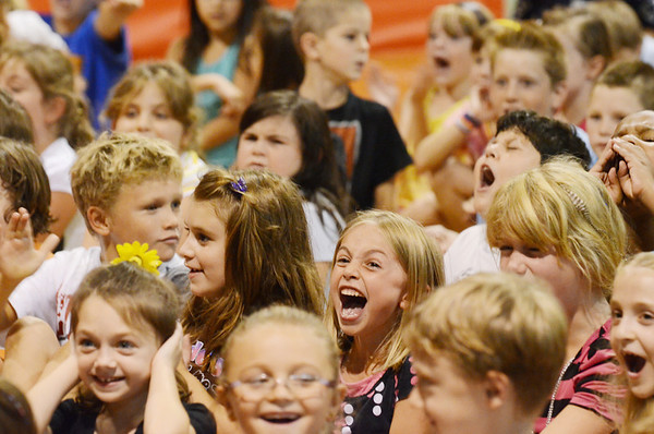 """Peabody: Students at West Memorial Elementary School cheer during an assembly in celebration of the 198,551 minutes they read for a summer reading program called """"One World Many Stories,"""" which was  in partnership with the Peabody Institute Library.  photo by Mark Teiwes / Salem News"""