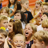 "Peabody: Students at West Memorial Elementary School cheer during an assembly in celebration of the 198,551 minutes they read for a summer reading program called ""One World Many Stories,"" which was  in partnership with the Peabody Institute Library.  photo by Mark Teiwes / Salem News"