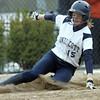 Beverly: Endicott College softball player Jesse Bilafer slides safe into home. Roger Williams  photo by Mark Teiwes / Salem News