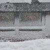 Beverly: A Subway shop flashes it's open sign as a heavy snow falls on Wednesday.  photo by Mark Teiwes / Salem News