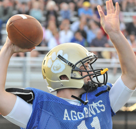 Lynn: Bishop Fenwick's Bret Kidik warms up at the 50th annual Agganis All-Star Football Classic .  photo by Mark Teiwes  / Salem News