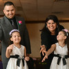 "Salem Jaime and Mayra Avila do the ""hokey pokey"" with their 5-year-old daughters Adriana, left, and Ariana during a ball organized by Head Start at the Salem Knights of Columbus.    photo by Mark Teiwes"