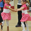 Salem: 4-year-olds Roniyah Francis, left, and Alyssandra Bell both from Salem dance together at the Mayor's annual Easter egg event.  photo by Mark Teiwes