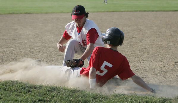 Marblehead: Salem Senior Babe Ruth baseball player Tyler Madden, right, slides safe into third covered by Marblehead's Evan Haferman.     photo by Mark Teiwes / Salem News