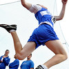 Lynn: At the Northeastern Conference track meet Danvers High School athlete Corey Walker launches during a triple jump attempt.  Photo by Mark Teiwes / Salem News