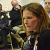 Marblehead: Julie Castner, right, addresses the Marblehead Board of Selectmen recounting the police department's response to her daughter's death.  Police Chief Robert Picariello, left, listens to her comments.  photo by Mark Teiwes / Salem News