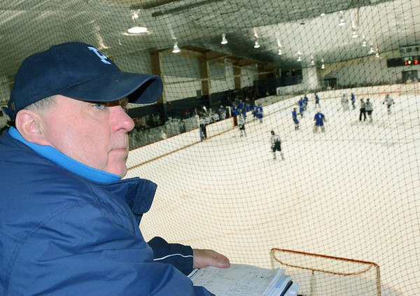 Peabody: Peabody High School assistant boys hockey coach Bo Tierney looks out as his team plays Danvers.  photo by Mark Teiwes  / Salem News
