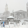 Salem: People wait for the commuter rail as Downtown Salem is plastered with snow. photo by Mark Teiwes / Salem News
