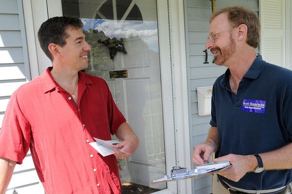 Beverly: State Representative candidate Scott Houseman, right speaks with Jim Povey while campaigning door to door along Bass River Road in Beverly. photo by Mark Teiwes / Salem News