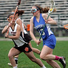 Beverly: Danvers player Katie McKenna, right, advances upfield covered by Beverly's Lainey Bernfeld.  photo by Mark Teiwes