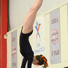 Beverly: Beverly High School sophomore Libby Rosenberry pulls off a half-half on the vault. photo by Mark Teiwes / Salem News