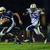 Peabody: Peabody quarterback #15 Jason Hiou eludes Danvers lineman Connor Morrison.  photo by Mark Teiwes