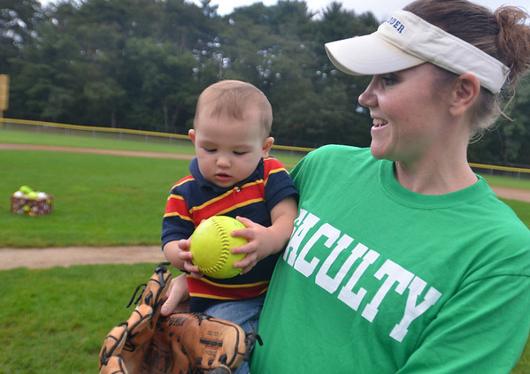 "Beverly: Beverly High School math teacher Ellie Henebury holds her 11-month-old son Clyde.  She plays for the Faculty team in the annual ""Momball"" softball tournament. Games continue 5:30 Friday at the Harry Ball Field.   photo by Mark Teiwes / Salem News"