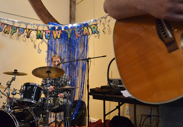 Wenham: Drummer Roger Brockelbank brings in the new year at the  Wenham Museum. photo by Mark Teiwes  / Salem News