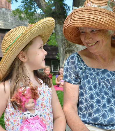 Topsfield: Ellie Posanka, 6, and her grandmother Chalotte O'Tolle of Boxford enjoy time together during the annual doll tea event at the Gould Barn.  photo by Mark Teiwes /  Salem News